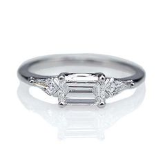 Replica Art Deco Engagement Ring � east/west set emerald cut diamond
