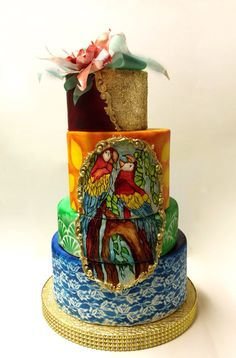 Handpainted cake With airbrush details and wafer paper exotic flower ( by Duygu Tugcu- instagram:pastacanavari)
