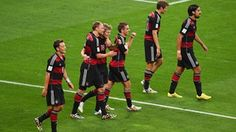 Toni Kroos of Germany celebrates scoring his team's fourth goal and second of the game with teammates during the 2014 FIFA World Cup Brazil Semi Final match between Brazil and Germany at Estadio Mineirao on July 8, 2014