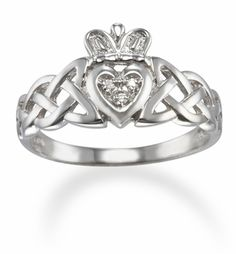 Diamond and 14kt white gold Irish Claddagh ring with a Trinity Celtic knot band. (334FC34R) $398. - Now THIS would be a dream wedding ring :)