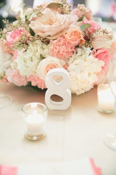 Pink and Ivory Centerpieces with Modern White Table Numbers   Onelove Photography   See More! http://heyweddinglady.com/pink-mint-and-gold-w...