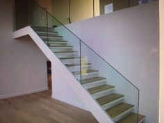 GLASS STAIRCASE TO REPLACE EXISTING INTERNAL STAIRCASE