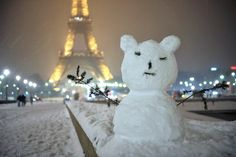 A snowman greets pedestrians on January 19, 2013 in Paris.