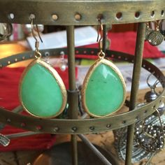 Green and gold tone earrings A nice weight with gold tone surrounds and wires. Small black flecks in on earring. Jewelry Earrings