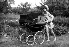 Audrey Hepburn (best actress, 1954, Roman Holiday) pushes her son Luca in a stroller. Photographed by Henry Clarke for Vogue, 1971.
