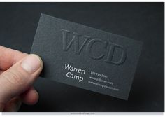 Photo Editor: This is not a photograph! Using Photoshop, Warren created a sample embossed-logo card that he seemingly placed within the fingers of a model shown in a stock photo.