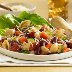 Pasta salad, inspired by Minestrone Soup, combines pasta with kidney beans, flavored tomatoes, zucchini and carrots for  lots of flavor and color