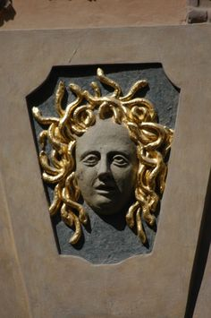 Prague: House Signs--Medusa in Nerudova street no. 14 (signs from pre-numbering days)
