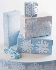 Create Gift Tags and Trimmings Paper Snowflake Ideas and Templates | Martha Stewart Living — Paper snowflakes aren't quite as delicate as the real things are, but they make a fine filigree with which to adorn your holiday gifts, nonetheless.