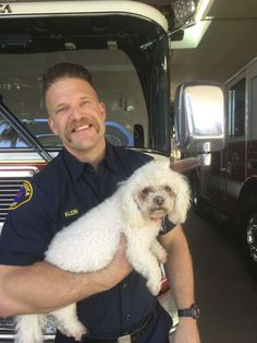 In this photo released by dog owner Crystal Lamirande, Santa Monica Firefighter Andrew Klein holds Nalu in Santa Monica, Calif., on Thursday, March 23, 2017. Klein spent several minutes giving mouth-to-snout resuscitation to the dog, who was pulled from a burning apartment in Santa Monica. (Crystal Lamirande via AP) Photo: Crystal Lamirande, AP / Copyright 2017 The Associated Press. All rights reserved.