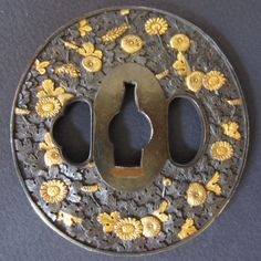 Antique Japanese Tsuba motif of Chrysanthemums