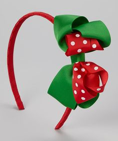 Have a holly jolly holiday with the help of this ribbon-wrapped headband. Bows and festive polka dots mean that Santa's little helper is well equipped to take an extra-cute family photo.