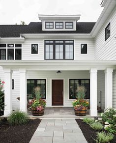 Z+ Architects | Residential |  Architecture | Exterior | Front | Yard | Geometry | Windows |  Gable | Home | Entry | Curb Appeal | Porch | Modern | Farmhouse | White | Columns | Door | Transom | Shed Dormer