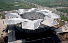 The Qi Zhong stadium is a sports arena in Shanghai. Kinetic Architecture, Stadium Architecture, Concept Architecture, Contemporary Architecture, Architecture Design, Beautiful Architecture, Shanghai, Bobsleigh, Zaha Hadid