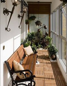 Recreate your very own botanical garden in your balcony apartment. Play around with hanging and potted plants as well as pebbles for the floor. Add an accent of the medieval theme with some wall lamps.