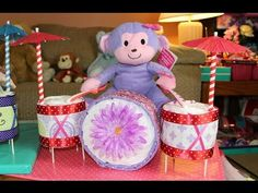 My Quick Diaper Cake Drum Set Video Tutorial. I hope you like it! 36 Size 1 Diapers 4 Receiving Blankets 1 Pack of Paper Straws (Plastic Straws can work too). Baby Shower Crafts, Baby Crafts, Baby Shower Parties, Shower Gifts, Unique Diaper Cakes, Diy Diaper Cake, Nappy Cakes, Diaper Cakes Tutorial, Diaper Cake Instructions