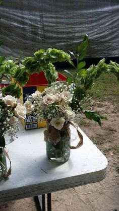These were the hanging mason jar flowers for the aisles - the baby roses were spectacular and have lasted for many days after the wedding too! not bad considering the 90+ temps!!