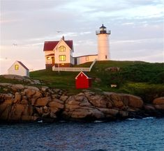 I could sit out at Nubble Lighthouse in Cape Neddick, Maine all day  and not get tired of this beautiful scene: http://www.visitingnewengland.com/southern-maine-coast.html