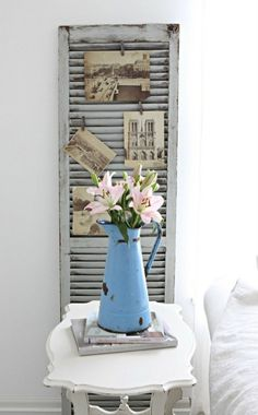 shutter of memories.Great idea buy and old shutter and paint it and pin up old card or photo's..love it :)