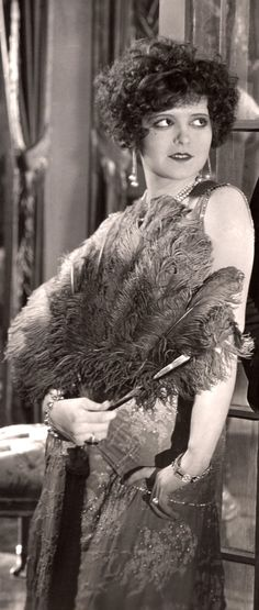 "clarabowarchive: ""Clara Bow with curly hair and feather fan in Eve's Lover (1925). """
