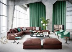 Post-industrial elegance with a strong color identity in brown and green. Discover the living room by @poltronafrauofficial with Massimosistema sofa and ottomans and the iconic Dezza armchair designed by #GioPonti. #archiproducts #poltronafrau