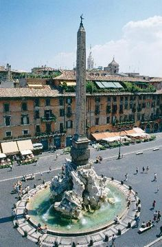 Looking down on Bernini's fountain and obelisk, the Fontana dei Quattro Fiumi 'Fountain of the Four Rivers', lies at the heart of the Piazza Navona, Rome