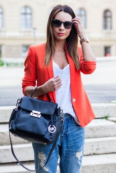 I love her casual look that's disguised by how it's actually really trendy and though out.  Though the jeans look worn and vintage, they look upmarket.  The shirt might be plain but the cut and fabric are very modern.  Blazer is a cute touch--but the orange makes it edgy.  Her hair is sleek, sunglasses modern and watch trendy,  I don't like the bag--not a fan of MK bags and the hardware is too much.  Otherwise, very downplayed cool.