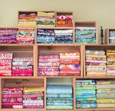 A sunny sewing room and folding fabrics to size.