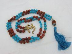 Spiritual Gift- Rudraksha Turquoise Bead Prayer Yoga Meditation Japa Mala with Om Pendant ~ 108 + 1 Bead Yoga Jewelry mogul interior, http://www.amazon.com/gp/product/B009OAT99A/ref=cm_sw_r_pi_alp_mhIDqb1K253WF