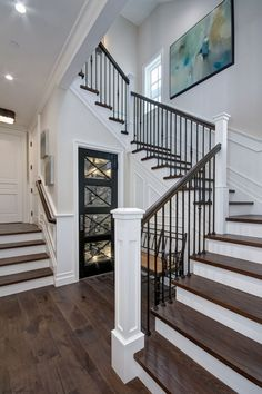 The staircase features White Oak wood treads and custom wrought iron spindles. The staircase features White Oak wood treads and custom wrought iron spindles. Wrought Iron Staircase, Staircase Railings, Banisters, Staircase Ideas, Iron Spindle Staircase, Open Staircase, Spindles For Stairs, Wrought Iron Spindles, Victorian Houses