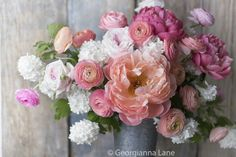 @ Georgianna Lane peonies and ranunculus with pops of coral