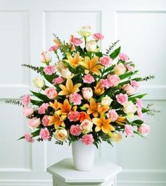 White Asiatic lilies and green hydrangea are arranged in a clear glass trumpet vase with curly willow, making a sophisticated altar arrangement. Your purchase includes a complimentary personalized gift message. Altar Flowers, Church Flowers, Funeral Flowers, Wedding Flowers, Funeral Flower Arrangements, Church Flower Arrangements, Beautiful Flower Arrangements, October Flowers, Sympathy Flowers