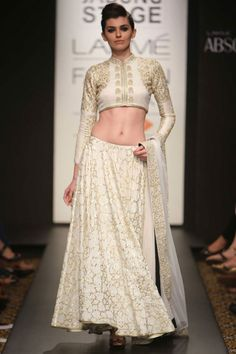 Off white zardosi and pitta embroidered lehenga set. Even though White is considered inauspicious in our culture, it would make a great statement with a fuschia dupatta