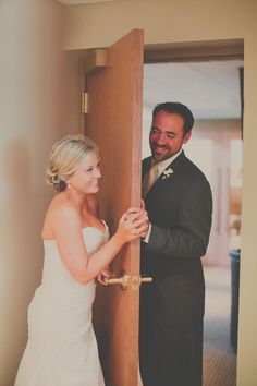 Love this idea: bride and groom touch hands but don't see eachother right before the ceremony. Makes for a great photo