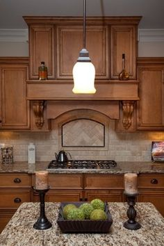 I like the look of the back splash behind the stove. Oakley Home Builders traditional kitchen