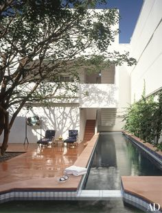 """With the courtyard and terraces, the house offers me a full interior and exterior life,"" Huston remarks. ""I'm a Cancer. I have both of what I need here, which is comfort and places to escape to in the house and—so important—the sense of never feeling hemmed in."" A lap pool, which is joined by a Jacuzzi, forms the western edge of the courtyard."