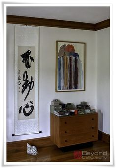 Aligning the space on the walls. Calligraphy by Rona Conti