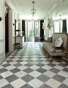 Veranda's House of Windsor which features Antique white marble with Dalle de France Monfort limestone from Exquisite Surfaces.