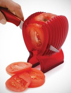 The Tomato Slicer and Knife Tomatoes, potatoes, onions, whatever--this gizmo holds them steady while you cut, one-hand ninja-style. Joie ($12)
