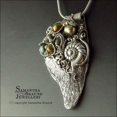 Pendant | Samantha Braund.  'Olive Pearl Barnacle Cluster'  Metal clay and fresh water pearls.