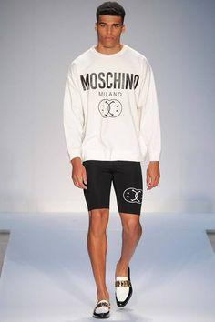 White sweatshirt with interlocking smileys design paired with black bike shorts with matching design by @moschinofficial. #IStyleNY #Style