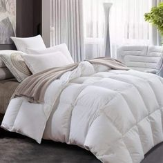 All Seasons Lightweight White Goose Down Comforter Hypo-allergenic Duvet Insert. Filled with White Goose Down, this Duvet Insert 600 Thread Count Sewn Through construction,no leaking feathers. Down Comforter Bedding, White Down Comforter, Comforter Sets, Cotton Bedding, White Comforter Bedroom, Striped Bedding, Attic Master Bedroom, Farmhouse Master Bedroom, Bed Sheet Sets