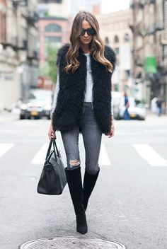 fall outfit, winter outfit, casual outfit, night out outfit, fall layers - black fur vest, stripe long sleeve t-shirt, dark grey skinny jeans, black suede heeled boots, black handbag, black square sunglasses