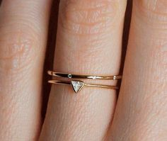 Love the trend of delicate wedding rings. | See more simple #wedding rings here: http://www.mywedding.com/articles/simple-wedding-rings-youll-love/