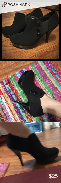 Black Booties with Button Accents Brand new, never worn except for the picture and to try on. Super cute and comfortable. The heel is about 3 1/2 inches, but I can measure exactly if asked. The size is 7m. Unlisted Shoes Ankle Boots & Booties