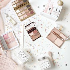 Makeup flatlay with confettis.