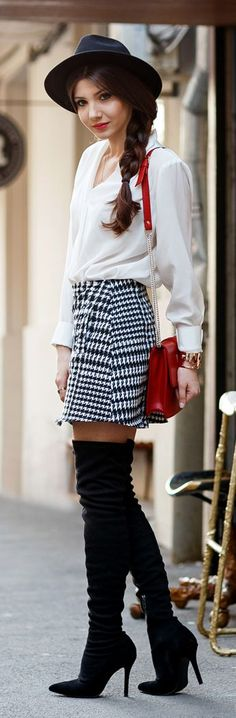 Houndstooth skirt, white blouse, red bag, and chic black fedora hat, thigh high boots, side braid