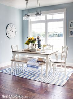 Pretty blue dining room with a white table and dark wood top and bench. {House Tour - The Lilypad Cottage}
