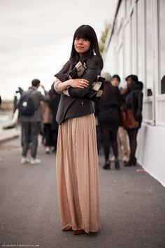 Do a pink maxi skirt with simple gray blazer