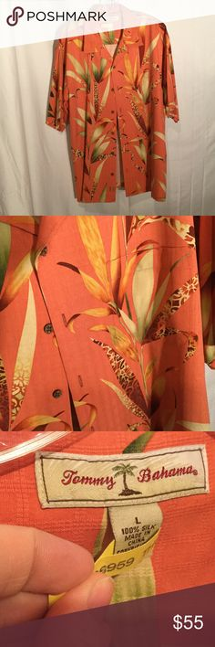 Men's 💯 silk Tommy Bahama camp shirt worn once L Men's 💯 silk camp shirt in salmon background with shades of greens browns mixed in to create a dramatic print of tropical reeds. Really beautiful and unique print . Size L and fresh from dry cleaner having been worn once only Tommy Bahama Shirts Casual Button Down Shirts